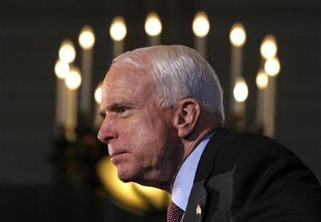 Presumptive Republican presidential candidate US Senator John McCain listens to a question during a news conference after delivering a speech to the Economic Club of Canada in Ottawa, June 20, 2008. REUTERS/Chris Wattie