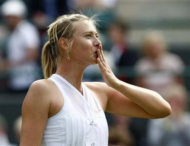 Maria Sharapova of Russia celebrates after defeating Stephanie Foretz of France in their match at the Wimbledon tennis championships in London June 24, 2008. REUTERS/Alessia Pierdomenico