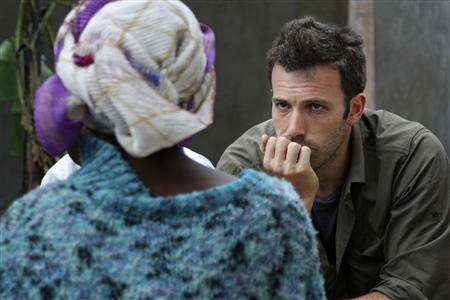 Actor Ben Affleck (R) is pictured as he listens to a woman in Congo in this undated publicity photograph. Affleck's personal essay on his travels through the Congo will be telecast on ABC's news program ''Nightline'' on June 26, 2008. REUTERS/Max Culhane/ABC News/Handout
