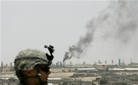 A U.S. soldier of the 1/8 Infantry Battalion keeps watch from the roof of a building during a battlefield circulation patrol in Mosul June 25, 2008. REUTERS/Eduardo Munoz