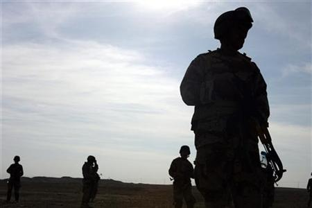 Iraqi soldiers conduct foot patrols through Sad'ah, one of Iraq's western Al Anbar Province cities, in this picture taken March 31, 2006. REUTERS/Cpl. Antonio Rosas/U.S. Marines/Handout