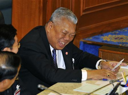 Thailand's Prime Minister Samak Sundaravej smiles during a no-confidence vote at the Parliament House in Bangkok June 27, 2008. REUTERS/Sukree Sukplang