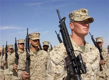 U.S. Marines march during a ceremony where the authorities handed over the town of Heet to Iraqi forces, in Anbar province, February 14, 2008. REUTERS/Ammar Dulaimi
