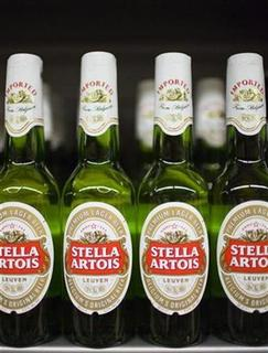 Bottles of Stella Artois beer, a brand of InBev, at a store in Hong Kong's Sheung Wan district June 12, 2008. REUTERS/Victor Fraile