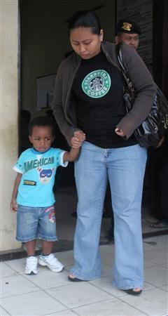 Sriyatmi, and her son Odi, partner of Nigerian Hansen Anthony Nwaoysa arrive back at Cilacap harbour after being refused entry to see her partner on Nusakambangan prison island June 26, 2008. Nwaoysa and another Nigerian Samuel Iwachekawu Okoye, convicted for drug smuggling have been executed by firing squad in Indonesia, officials said on Friday. REUTERS/Stringer