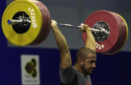 Ivan Stoitsov of Bulgaria lifts the bar to win the gold medal in the men's 77kg clean and jerk at the World Weightlifting Championships in Chiang Mai, Thailand September 21, 2007. REUTERS/Sukree Sukplang