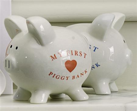 Piggy banks in an undated photo. Consumers banked a big portion of their tax rebate checks last month, giving them enough cushion to keep spending for a few more months and perhaps postponing a recession that once seemed inevitable. REUTERS/Handout