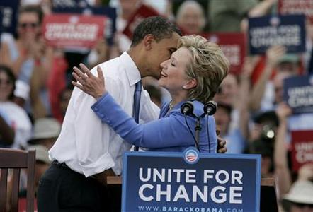 Democratic presidential candidate Senator Barack Obama and Senator Hillary Clinton embrace on stage with Clinton endorsing Obama in person and campaigning with him for the first time in the town of Unity, New Hampshire, June 27, 2008. REUTERS/Jim Bourg