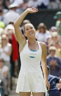 Jelena Jankovic of Serbia waves after defeating Caroline Wozniacki of Denmark in their match at the Wimbledon tennis championships in London June 28, 2008. REUTERS/Kieran Doherty