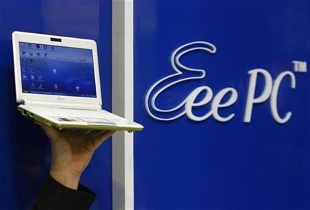 A model poses with the new version of Asustek's low cost notebook ''Eee PC'' during the 2008 Computex exhibition in Taipei June 4, 2008. REUTERS/Nicky Loh