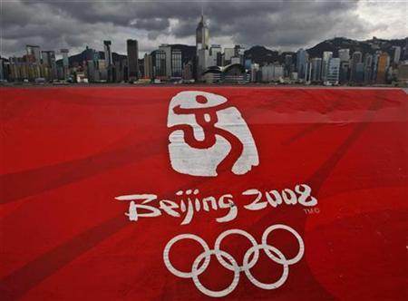A 2008 Beijing Olympic Games poster is displayed on the waterfront opposite to the Hong Kong island skyline June 24, 2008. REUTERS/Bobby Yip