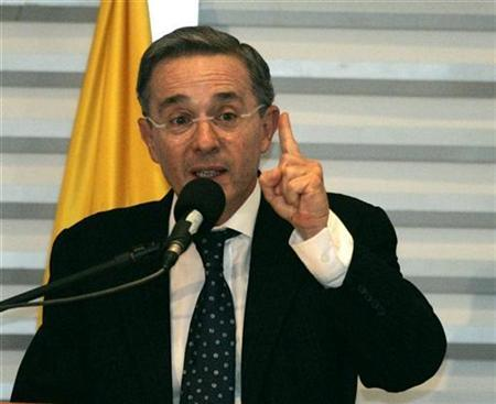 Colombia's President Alvaro Uribe speaks during a conference about political security in Bogota, June 13, 2008. REUTERS/Jose Miguel Gomez