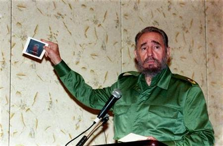 Fidel Castro shows a photograph of Cuban anti-Castro activist Luis Posada Carriles while addressing the media in Panama City in this November 18, 2000 photograph. REUTERS/Prensa Latina