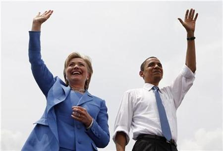 Democratic presidential candidate Senator Barack Obama and Senator Hillary Clinton appear on stage with Clinton endorsing Obama in person and campaigning with him for the first time in the town of Unity, New Hampshire, June 27, 2008. REUTERS/Jim Young