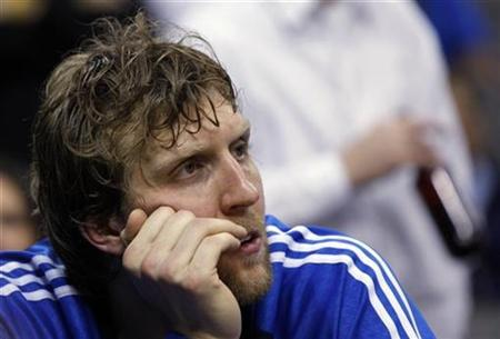 Dallas Mavericks Dirk Nowitzki watches the final moments of the second half of Game 4 of their NBA basketball playoff series against New Orleans Hornets in Dallas, Texas April 27, 2008. REUTERS/Jessica Rinaldi
