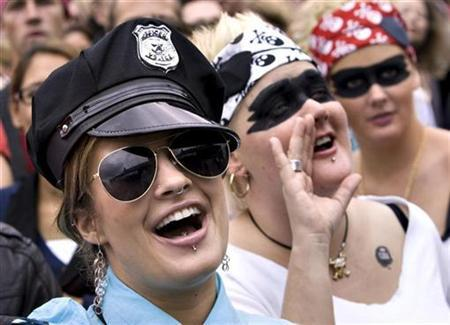 A participant of the Copenhagen Pride Parade dresses up as a policewoman in Copenhagen August 25, 2007. REUTERS/Keld Navntoft/Scanpix