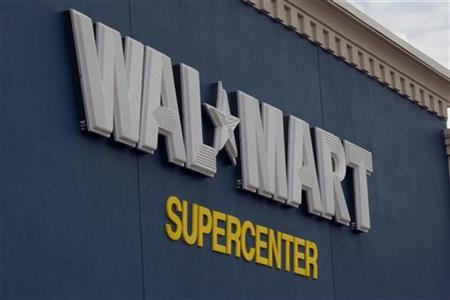 A sign marks the entrance of a Wal-Mart Supercenter in Rogers, Arkansas June 5, 2008. REUTERS/Jessica Rinaldi