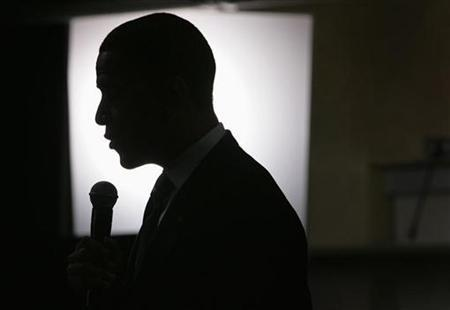Democratic presidential candidate Barack Obama is silhouetted by a television light during a campaign visit to the Springs Preserve in Las Vegas, Nevada, June 24, 2008. The 2008 presidential race, which has already drawn a record number of dollars and voters, is poised to shatter another record: the amount of money spent on television advertisements. REUTERS/Steve Marcus/Las Vegas Sun
