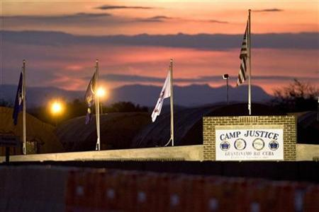 The sun sets over Camp Justice and its adjacent tent city, the legal complex of the U.S. Military Commissions, at Guantanamo Bay U.S. Naval Base, in Cuba, June 4, 2008. REUTERS/Brennan Linsley/Pool