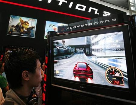 A gamer plays a Sony Playstation 3 game in a file photo. Nintendo's Wii game console once again outsold Sony's PlayStation 3 in Japan in June, but its lead is fading, a game magazine publisher said. REUTERS/Vivek Prakash