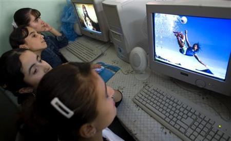 Iraqi Christian refugee children work on computers in a school run by Father Rodolfo Antoniassi in Istanbul, in this file picture dated September 25, 2006. REUTERS/Jerry Lampen