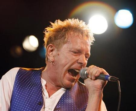 Lead singer Johnny Rotten performs with the Sex Pistols at the Roxy bar in Los Angeles, October 25, 2007. REUTERS/Mario Anzuoni