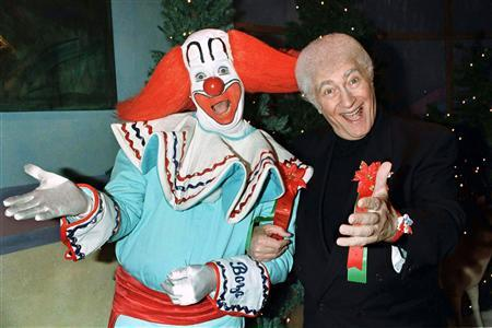 Larry Harmon (R), who popularized the ''Bozo the Clown'' character and portrayed ''Bozo'', is shown in this December 1, 1996 file photograph at a VIP party hosted by the Hollywood Christmas Parade with ''Bozo'', one of the more than 200 clowns he has trained to play the role. Harmon, 83, died of congestive heart failure in Los Angeles on July 3, 2008 according to his publicist Jerry Digney. REUTERS/Fred Prouser