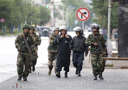 Soldiers patrol on a street in Ulan Bator, Mongolia, July 4, 2008. The ruling Mongolian People's Revolutionary Party (MPRP) has won parliamentary elections by a landslide, preliminary results showed on Thursday, after charges of election cheating sparked violence killing five people. REUTERS/Zeev Rozen