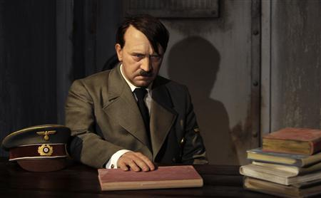 A waxwork of Adolf Hitler before a 41-year-old man tore its head off from the controversial exhibit on the opening day of Berlin's Madame Tussauds July 5, 2008 is seen in this July 3, 2008 file photo. REUTERS/Tobias Schwarz/Files