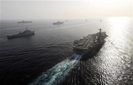 A photo released by the U.S. Fifth Fleet in Bahrain shows seven of nine U.S. warships in a flotilla, carrying 17,000 personnel, sailing in the Gulf May 22, 2007. REUTERS/U.S. Fifth Fleet/Handout