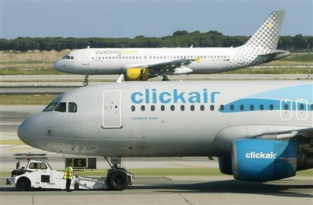 Clickair and Vueling planes are seen at El Prat airpot in Barcelona, July 7, 2008. REUTERS/Albert Gea