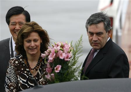 Prime Minister Gordon Brown (R) and his wife Sarah arrive at New Chitose airport near Sapporo July 7, 2008, for the Group of Eight (G8) Hokkaido Toyako Summit which begins on Monday. Britons can help bring food prices down by cutting the amount they waste every year, Prime Minister Gordon Brown said on Monday. REUTERS/Vivek Prakash