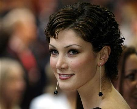 Australian singer Delta Goodrem arrives at the premier of Spider-man 2 in central London July 12, 2004. REUTERS/Kevin Coombs