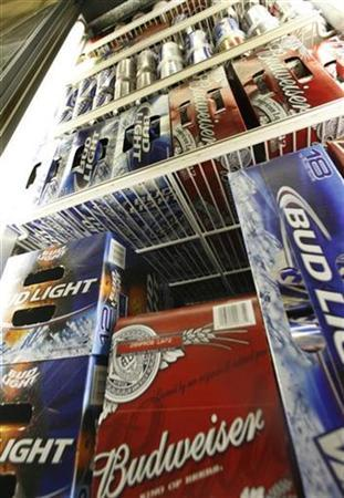 Bud Light and Budweiser beer is shown in a cooler at the Toluca Mart liquor store in Los Angeles, California June 16, 2008. I REUTERS/Fred Prouser