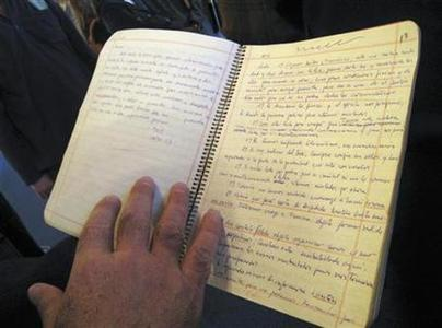 One of Ernesto ''Che'' Guevara's notebooks is displayed in La Paz, July 7, 2008. Bolivia's government unveiled notebooks that belonged to Guevara on Monday, including the diary he wrote during his failed attempt to spread revolution in the Andean country. Guevara was captured by CIA-backed Bolivian soldiers on October 8, 1967, and was shot the next day in a schoolhouse. REUTERS/David Mercado