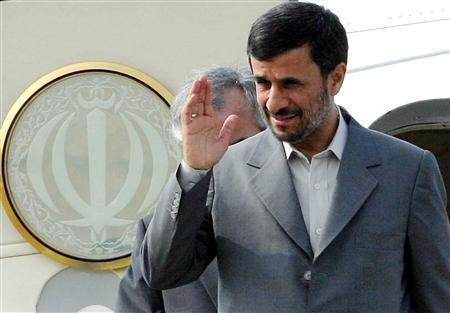 Iranian President Mahmoud Ahmadinejad waves as he arrives at Kuala Lumpur International Airport in Sepang July 7, 2008. REUTERS/Bernama