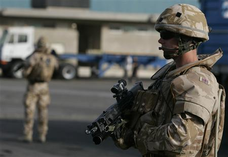 A British soldier stands guard during a patrol at Umm Qasr port in southern city of Basra, about 610 km southeast of Baghdad July 7, 2008. REUTERS/Atef Hassan