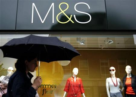 Shoppers pass a Marks and Spencer store in central London July 2, 2008. REUTERS/Luke MacGregor