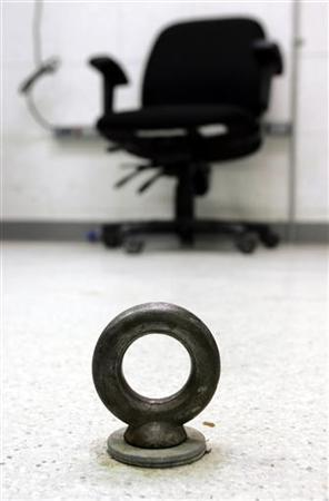 An eye bolt on the floor of an interrogation room is shown where detainees are interviewed at Camp Delta at the U.S. Naval Base Guantanamo Bay, Cuba July 28, 2004. REUTERS/Joe Skipper