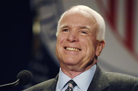 Republican presidential candidate Senator John McCain (R-AZ) smiles as he addresses a League of United Latin American Citizens conference in Washington, July 8, 2008. REUTERS/Jonathan Ernst