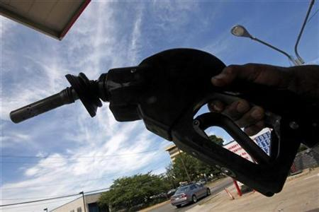 A gasoline pump nozzle is seen at a gas station as fuel prices continue to rise in Arlington, Virginia, June 11, 2008. REUTERS/Jim Young