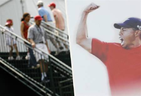 Fans pass a picture of Tiger Woods at the PGA Tour golf tournament in Maryland, July 3, 2008. Woods is on course to become the first billionaire athlete with the popular U.S. golfer proving a marketing dream, according to Forbes Magazine. REUTERS/Jonathan Ernst/Files