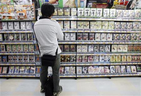 A man looks at video games at a shop in Tokyo's Akihabara district June 9, 2008. REUTERS/Yuriko Nakao