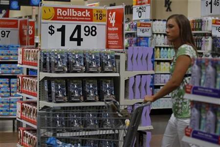 A customer pushes her shopping cart past a display at a Wal-Mart Supercenter in Rogers, Arkansas June 5, 2008. REUTERS/Jessica Rinaldi