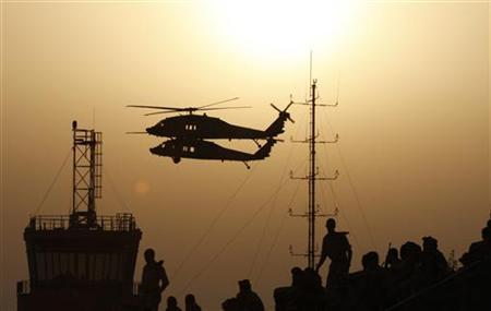 Israeli air force Black Hawks fly during an exhibition as part of a pilot graduation ceremony at the Hatzerim air base, southern Israel June 26, 2008. REUTERS/Baz Ratner