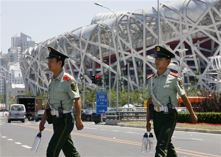 Chinese paramilitary police carry drinking water before taking their post near the National Stadium, also known as the Bird's Nest, in Beijing July 12, 2008. REUTERS/Claro Cortes IV