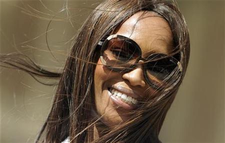 British top model Naomi Campbell smiles as she poses during an event to publicise 'Thisday's Music and Fashion Festival' at the Royal Albert Hall in London June 25, 2008. REUTERS/Dylan Martinez