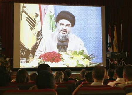 Lebanon's Hezbollah leader Sayyed Hassan Nasrallah speaks through a giant screen during a news conference in Beirut suburbs July 2, 2008. REUTERS/ Issam Kobeisy