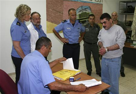 Israeli prison guards watch Lebanese prisoner Samir Qantar before his release from Hadarim prison, near the coastal city of Netanya, July 16, 2008. REUTERS/Israel Prison Service/Handout