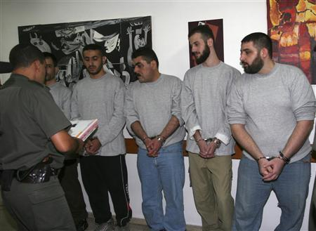 Lebanese prisoner Samir Qantar (3rd R) and four other prisoners wait before their release from Hadarim prison, near the coastal city of Netanya, July 16, 2008. REUTERS/Israel Prison Service Handout